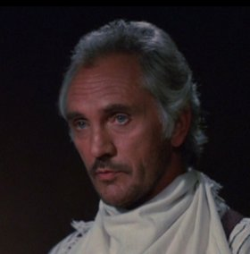 Terence Stamp as John Tunstall in Young Guns